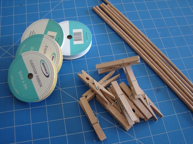 ribbon, wooden pegs, dowel