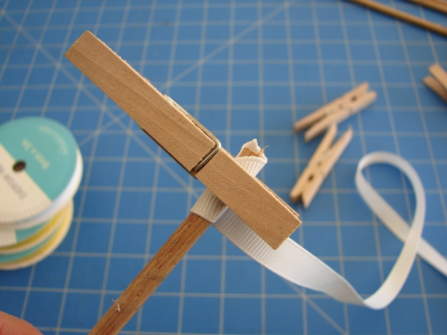 attache ribbon to dowel with a peg